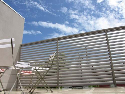 Enclose your patio with Louvre Blade Balcony Screen by Bayside Privacy Screens Bayside Privacy Screens Louvre Blade Balcony Screen
