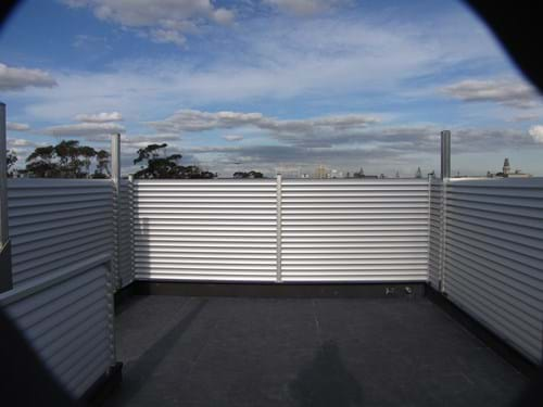 Louvre Blade Balcony Screens by Bayside Privacy Screens allow for the light to flow through