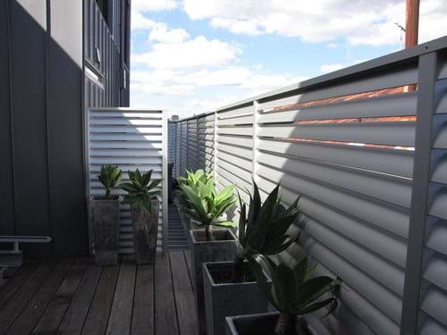 Louvre Blade Balcony Screening available in natural anodized or your choice of colour